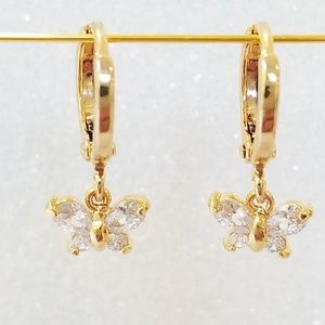 Gold huggie hoops with cz butterfly charm